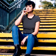 female on yellow stairs