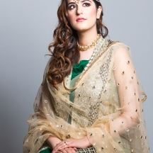 Bride looking towards light elegantly