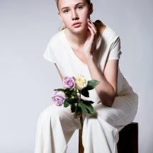 WHITE BEAUTY HOLDING FLOWERS